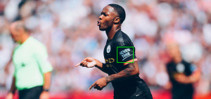 Manchester City soccer player with nexen tire on sleeve