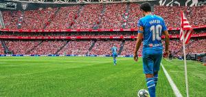 Valencia CF player in the stadium in a blue uniform